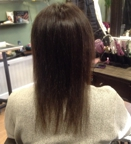 Before having hair extensions added, back view